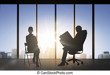 silhouette of business people working at office