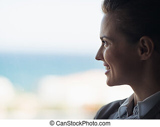 Silhouette of business woman looking into window