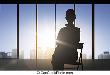silhouette of business woman sitting on chair