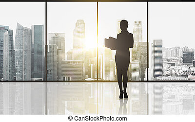 silhouette of business woman with folders