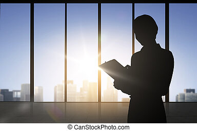 silhouette of business woman with tablet pc