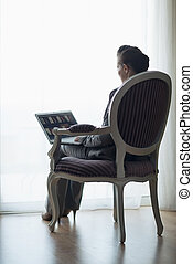 Silhouette of business woman working on laptop. rear view