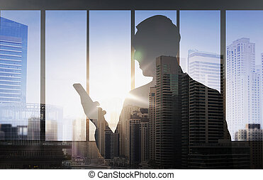 silhouette of businessman with smartphone