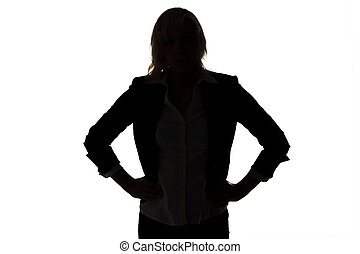Silhouette of businesswoman with hands on hips on white ...