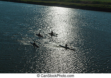 Silhouette of Canoes Competition on the River
