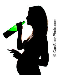 Silhouette of careless pregnant woman with alcohol and ...