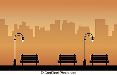Silhouette of chair and lamp on the street landscape
