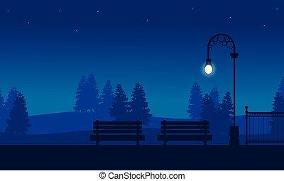 Silhouette of chair on garden landscape