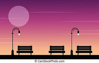 Silhouette of chair on street at sunset landscape