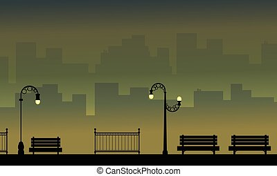 Silhouette of chair with lamp on the street landscape