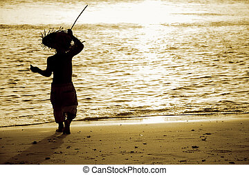 silhouette of child on sunset sea background