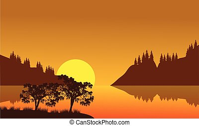 Silhouette of city and lake