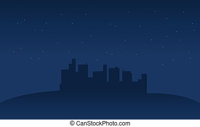 Silhouette of city in hills