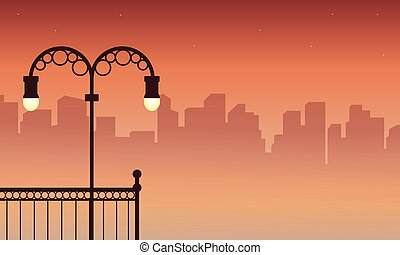 Silhouette of city street lamp scenery