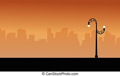 Silhouette of city with street lamp style scenery