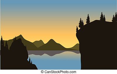 Silhouette of cliff on the lake