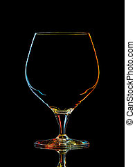 Silhouette of colorful whiskey glass with clipping path on black background