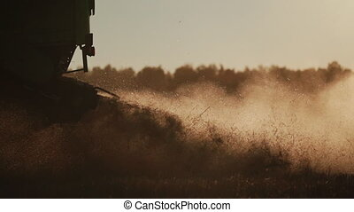 silhouette of combine straw chopper