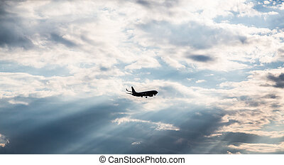 Silhouette of Commercial Jet Into Sunset - Commercial jet...