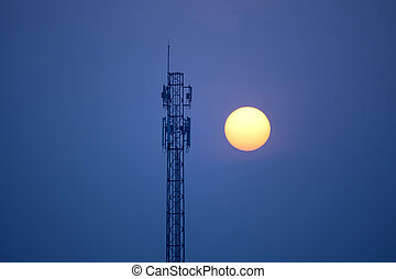 communication tower at sunset