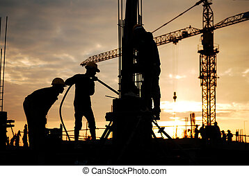 construction site - silhouette of construction worker on...