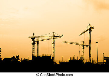 construction workers - Silhouette of construction workers on...