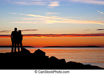 Silhouette of couple in sunset