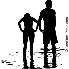 Silhouette of couple in the sea