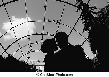 silhouette of couple on a sky background