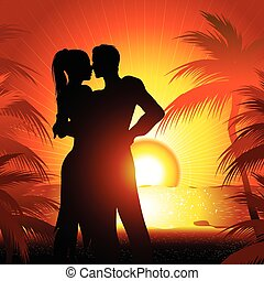 Silhouette of couple on beach at sunset dancing