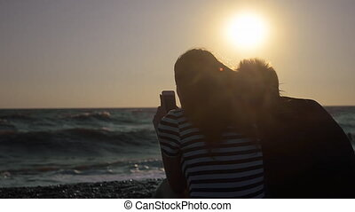 Silhouette Of Couple On The Beach L