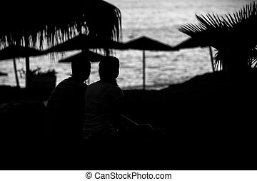 silhouette of couple on the beach