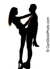 Silhouette of couple posing and hugging