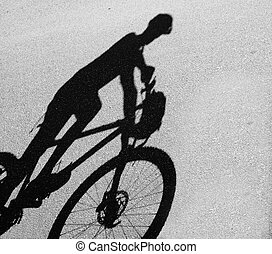 silhouette of cycling woman