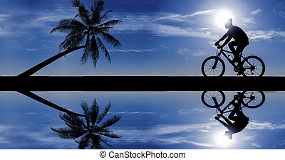 silhouette of cyclist in motion