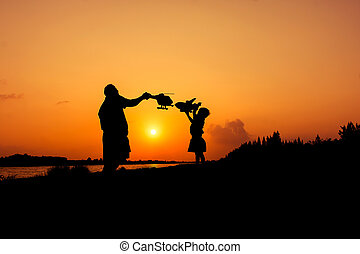 silhouette of dad and son plan plane sunset background