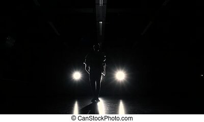Silhouette of dance performing man