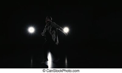 Silhouette of dance performing man - Silhouette of man on...