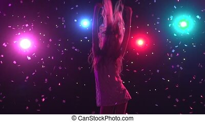 Silhouette of dancing girl with disco style lights. Slow motion