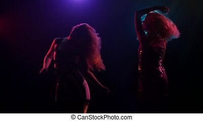 Silhouette of dancing girls with long hair in disco style