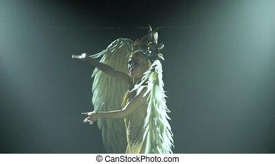 Silhouette of dancing Greek Goddess Artemis with wings on ...