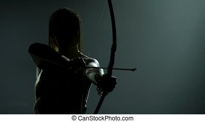 Silhouette of dancing Joan of Arc with bow and arrow on ...