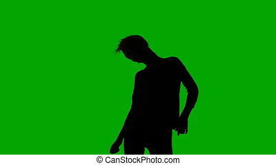 Silhouette of dancing slim girl