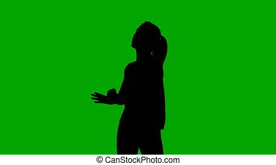 Silhouette of dancing slim woman