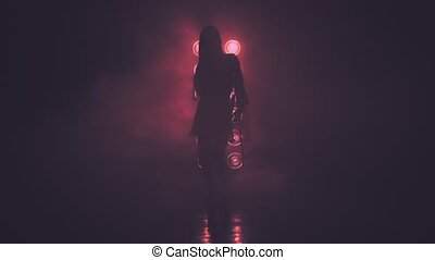 Silhouette of Dancing Woman in Smoke