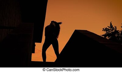 Silhouette of dancing woman