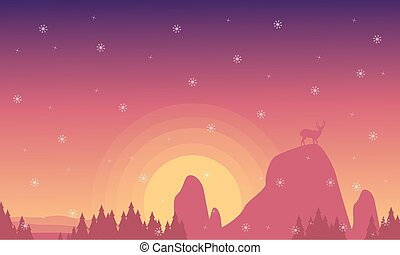 Silhouette of deer on the cliff