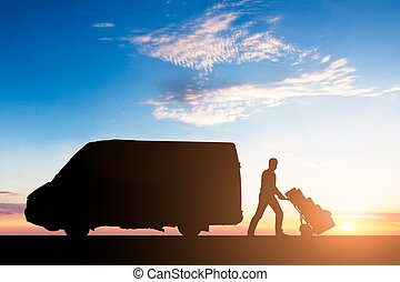 Silhouette Of Delivery Courier With Cardboard Boxes On Trolley