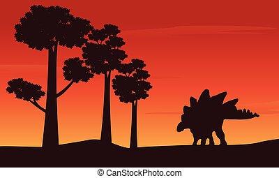 Silhouette of dinosaur stegosaurus on the hill