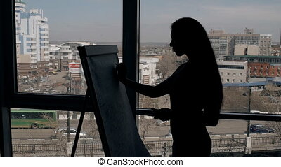 Silhouette of director expert businesswoman writing on a...